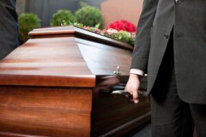 Pallbearer carrying coffin